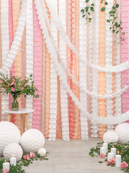 Guirnalda de papel tisú color rosa claro